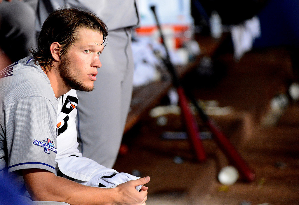 . Los Angeles Dodgers\' Clayton Kershaw rests his arm in the fifth as they defeat the Atlanta Braves 6-1 in the first game of the playoffs Thursday, October 3, 2013 at Turner Field in Atlanta, Georgia. (Photo by Sarah Reingewirtz/Pasadena Star- News)
