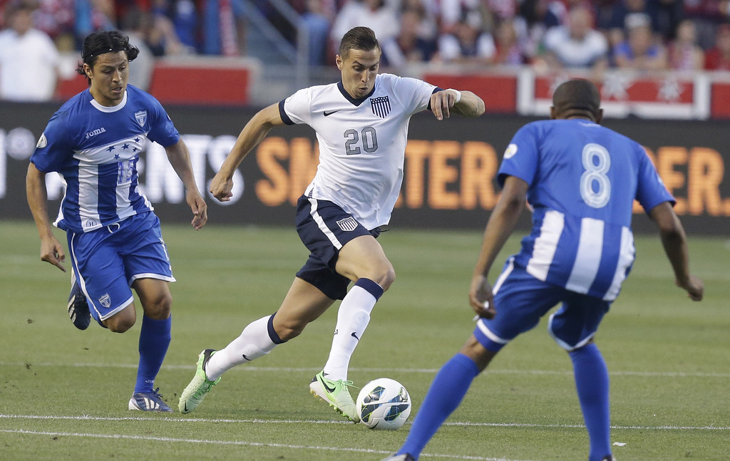 . The United State\'s Geoff Cameron (20)  drives against Honduras\' Roger Espinoza (15) and teammate Wilson Palacios (8) in the second half during an World Cup qualifying soccer match at Rio Tinto Stadium on Tuesday, June 18, 2013, in Sandy, Utah.  (AP Photo/Rick Bowmer)
