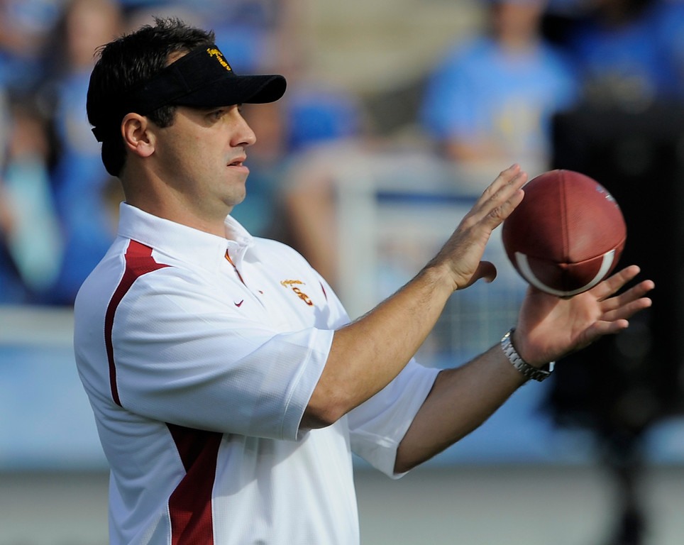 . Southern California\'s assistant coach Steve Sarkisian watches the team warm up before their NCAA college football game against UCLA at the Rose Bowl in Pasadena, Calif., Saturday, Dec. 6, 2008.  (AP Photo/Chris Carlson)