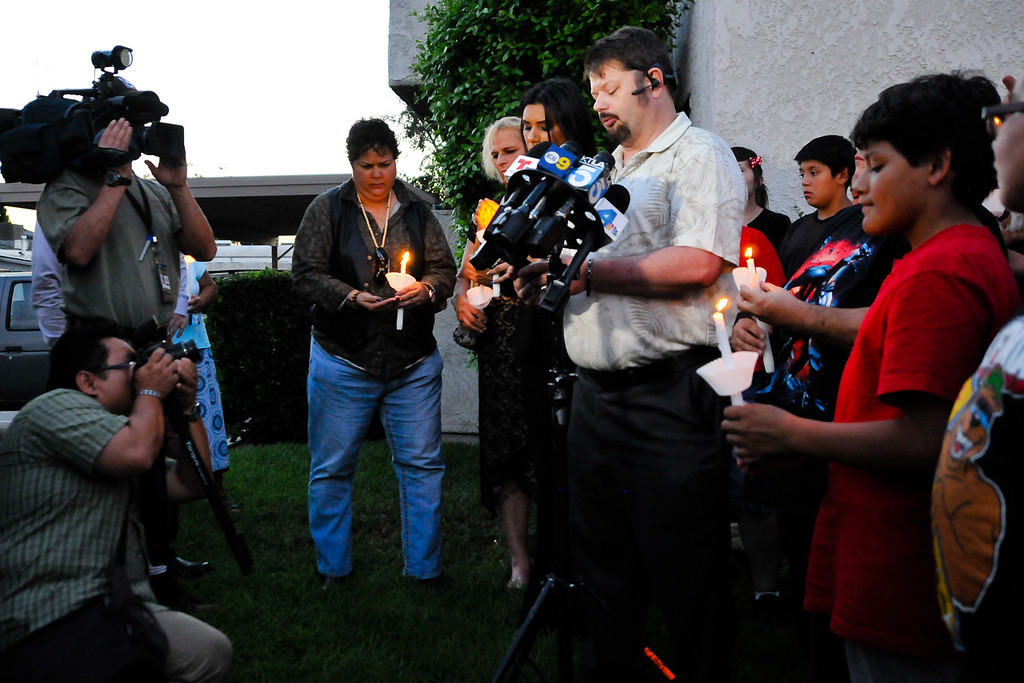 . Friends and supporters of Domonique Newburn, a Fontana transgender who was found dead on Tuesday, hold a candlelight vigil outside of Newburn\'s residence in Fontana on Wednesday, Aug. 21, 2013. Police have not made an arrest in the case, but say a man seen leaving Newburn\'s home in a Mercedes may be the suspect in the killing. The vehicle, which was found at Perris Hill Park Wednesday in San Bernardino, is believed to belong to Newburn. (Rachel Luna / Staff Photographer)