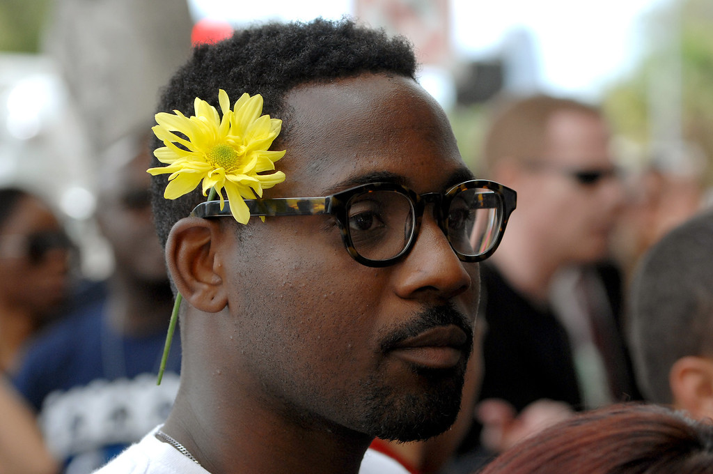 . Alex Stewart wears a daisy at a rally supporting LAUSD Superintendent John Deasy in front of LAUSD headquarters, Tuesday, October 29, 2013. (Photo by Michael Owen Baker/L.A. Daily News)