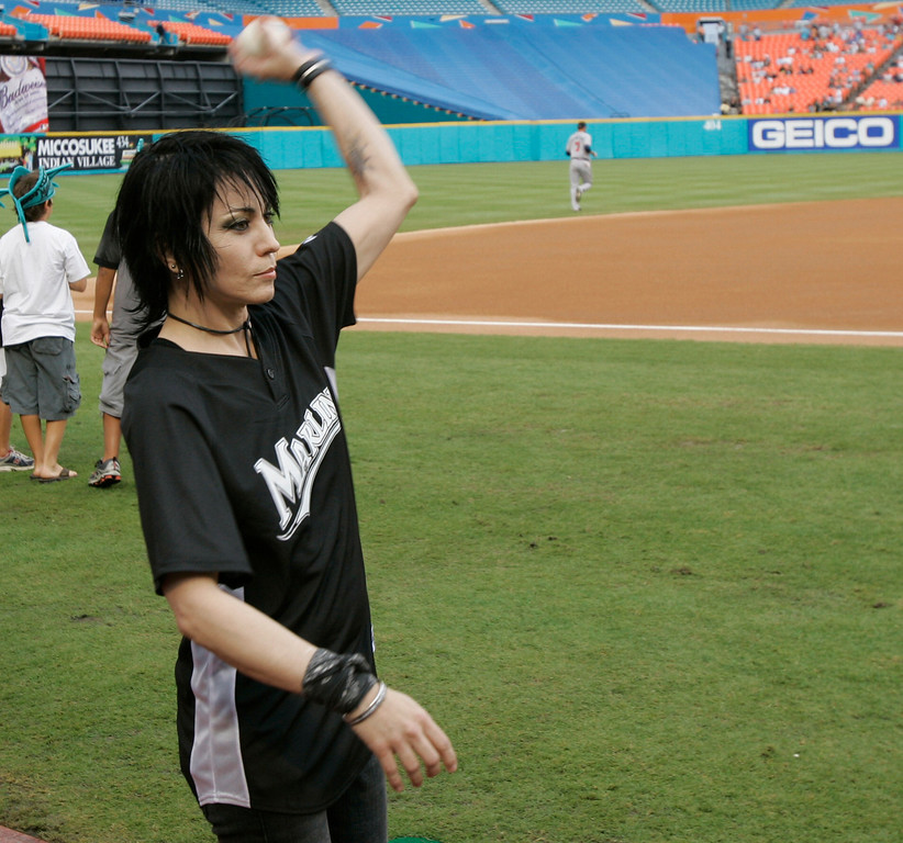 . Rocker Joan Jett warms up before a baseball game between the Florida Marlins and the Atlanta Braves on Saturday, June 30, 2007 in Miami. Jett, who will play in a post-game concert, threw out one of the ceremonial first pitches. (AP Photo/Wilfredo Lee)