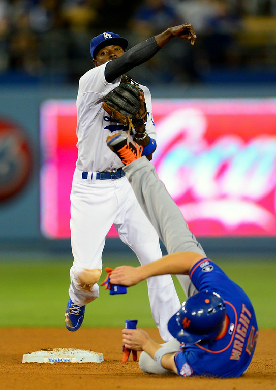 . The Mets\' David Wright slides into Dee Gordon with cleats up on the game-ending double play. (Photo by Michael Owen Baker/Los Angeles Daily News)