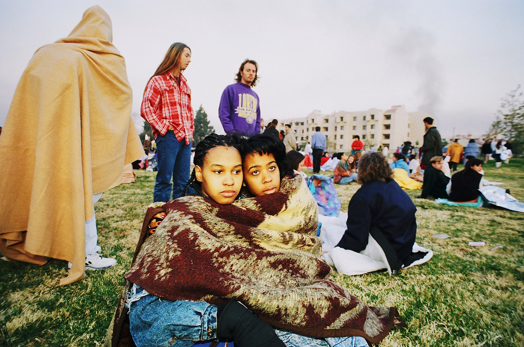 . Latanya Davis, left, and Stefanie Coston, students at CSUN, bundle up on a lawn in front of their dormitory as dawn breaks on Jan. 17.   Los Angeles Daily News file photo