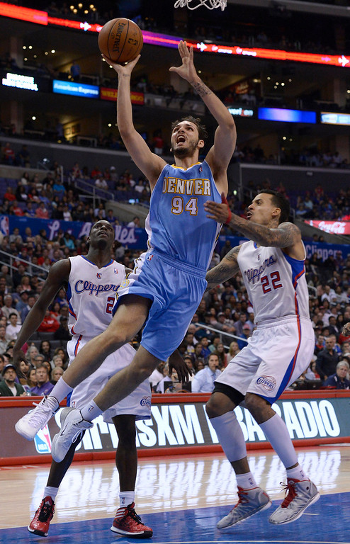 . Denver#94 Evan Fournier gets past Clippers#2 Darren Collison and Clippers#22 Matt Barnes in the second half. The Los Angeles Clippers defeated Denver Nuggets 117 to 105 in a regular season NBA game. Los Angeles, CA. 4/15/2014(Photo by John McCoy / Los Angeles Daily News)