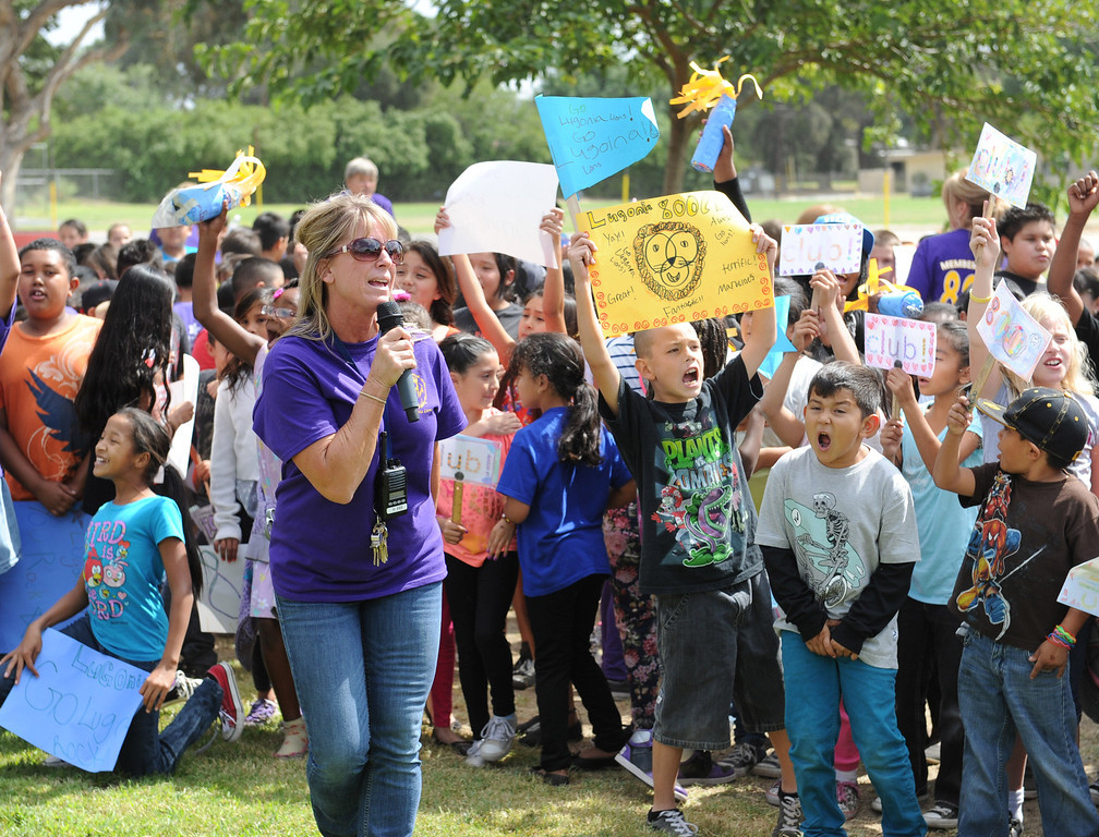 . (John Valenzuela/Staff Photographer) Vice principal Denise Fee of Lugonia Elementary in Redlands praises the students for their 808 API score, during an afternoon pep rally at the school, Thursday, September 26, 2013.