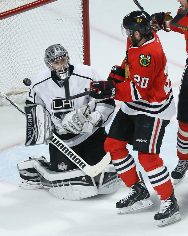 . Los Angeles Kings goalie Jonathan Quick (32) blocks a shot by Chicago Blackhawks left wing Brandon Saad (20) during the first period in Game 1 of the NHL hockey Stanley Cup Western Conference finals Saturday, June 1, 2013, in Chicago. (AP Photo/Charles Rex Arbogast)