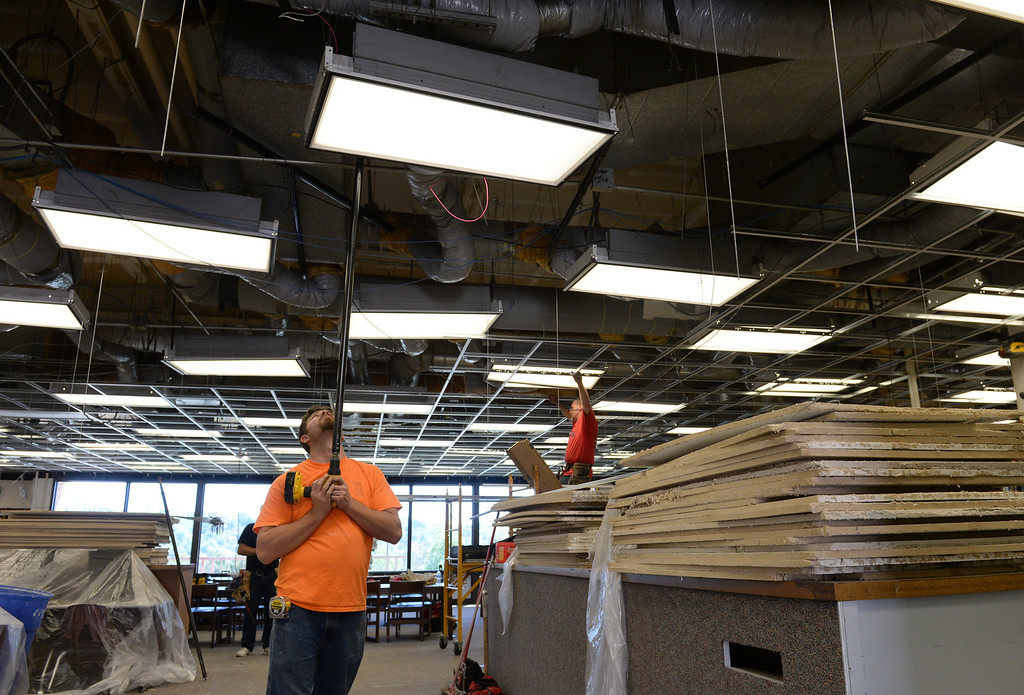 . Contractors work on replacing a damaged suspended ceiling in the library at Diamond Bar High School on Thursday April 3, 2014. Spring break repairs got more complicated after the recent earthquake damaged areas of the school in addition to planned repairs on campus. (Staff Photo by Keith Durflinger/Whittier Daily News)