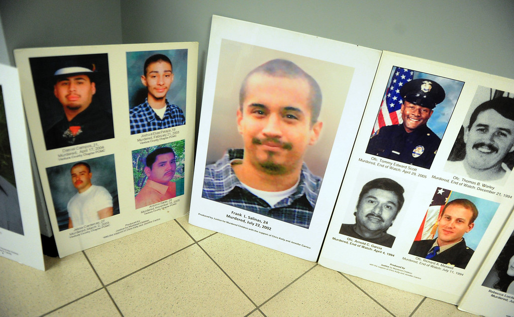 . A poster of Frank Salinas who was murdered in 2002 during a Los Angeles County Sheriff�s Department and Justice for Murdered Children unsolved homicide summit at the Los Angeles County Sheriff\'s headquarters on Saturday, July 20, 2013 in Monterey Park, Calif.  (Keith Birmingham/Pasadena Star-News)