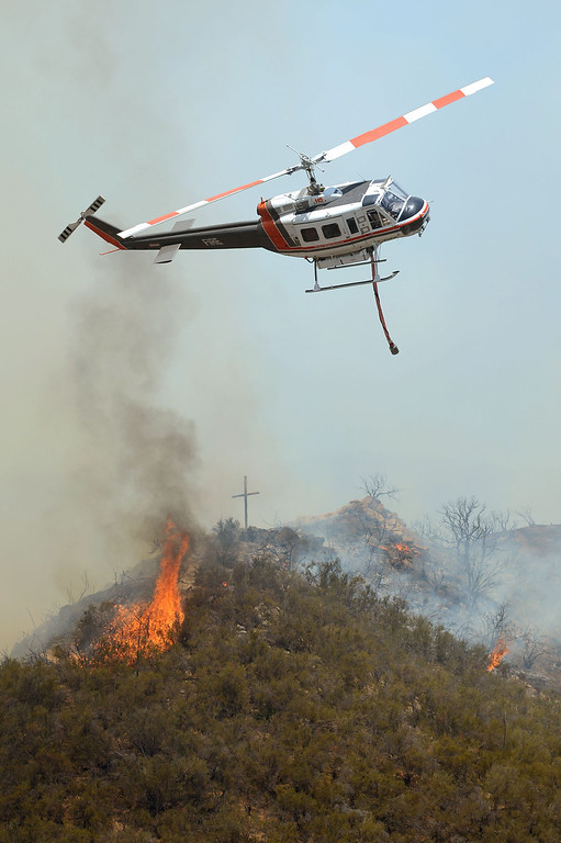 . A fire helicopter makes a pass over the Powerhouse Fire near Green Valley Friday, May 31, 2013.(Andy Holzman/Staff Photographer)