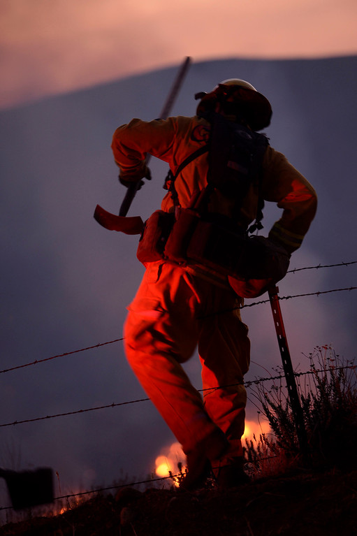 . Fire crews work the Summit Fire along Sunset Avenue in Banning May 1, 2013.  The fire has burned over 1700 acres and is only 30% contained.  CAL Fire, San Bernardino County, and Riverside County, and Riverside City Fire Departments have responded to the blaze which caused evacuations.  GABRIEL LUIS ACOSTA/STAFF PHOTOGRAPHER.