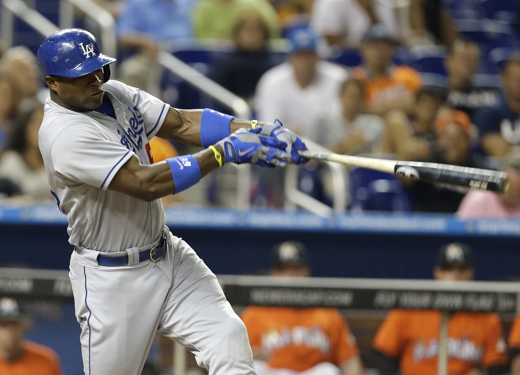 . Los Angeles Dodgers\' Yasiel Puig hits a solo home run in the eighth inning of a baseball game against the Miami Marlins, Tuesday, Aug. 20, 2013 in Miami. The Dodgers won 6-4. (AP Photo/Lynne Sladky)
