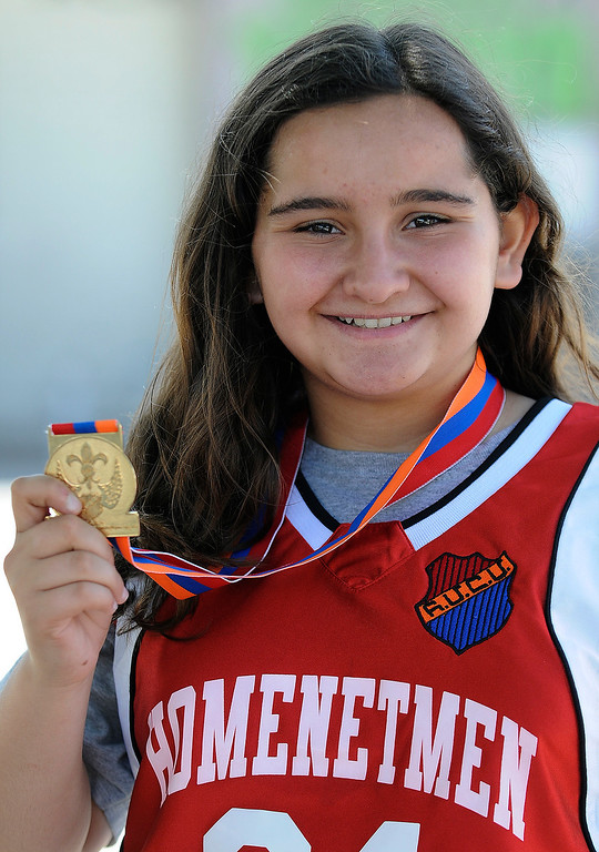 . Soseh Thomasian,12, shows off the medal she won. The months-long Homenetmen Navasartian Games, an Armenian athletic competition that involves thousands of competitors, concluded Saturday at Birmingham High School in Van Nuys, CA. 7/6/2013(John McCoy/LA Daily News)