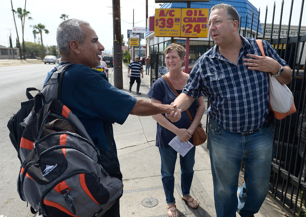 . Homeless man, Jesus Javier Sainz shakes hands with Michelle and Joe Di Benedetto after the family, along with their daughter Lexi, have him a bag of food and some water. Our Lady of Peace Parish and School hosted its first Love It Forward Event. Members of the parish, and community, went out into the streets to spread love with simple, random acts of kindness. North Hills, CA. March 29, 2014 (Photo by John McCoy / Los Angeles Daily News)
