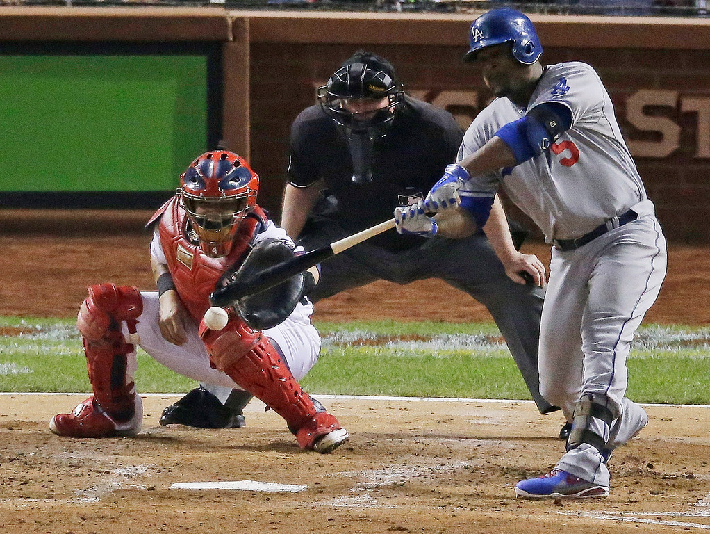 . Los Angeles Dodgers\' Juan Uribe hits a two-run scoring single during the third inning of Game 1 of the National League baseball championship series against the St. Louis Cardinals, Friday, Oct. 11, 2013, in St. Louis. (AP Photo/Chris Carlson)