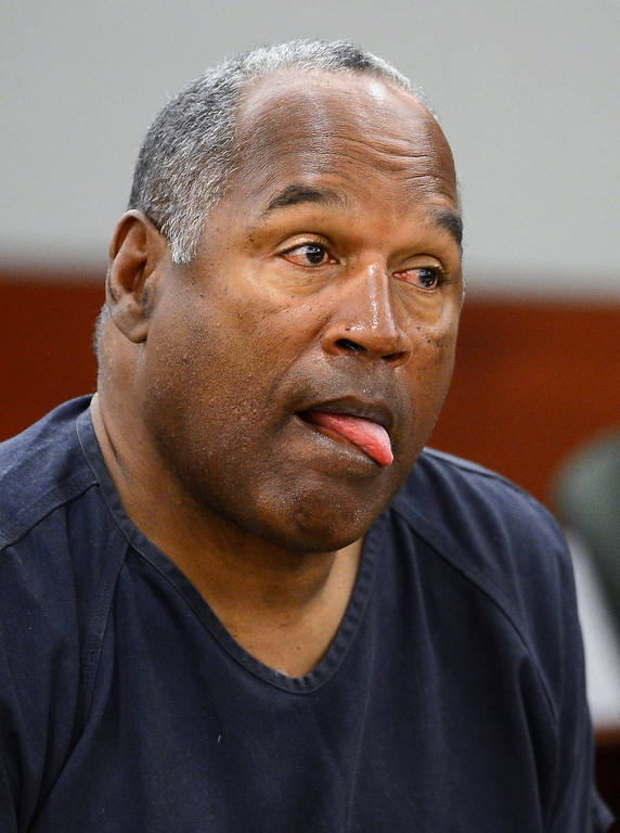 . O.J. Simpson appears during the second day of an evidentiary hearing for  Simpson in Clark County District Court, Tuesday, May 14, 2013 in Las Vegas.  The hearing is aimed at proving Simpson\'s trial lawyer, Yale Galanter,  had conflicted interests and shouldn\'t have handled Simpson\'s case. Simpson is serving nine to 33 years in prison for his 2008 conviction in the armed robbery of two sports memorabilia dealers in a Las Vegas hotel room.  (AP Photo/Ethan Miller, Pool)