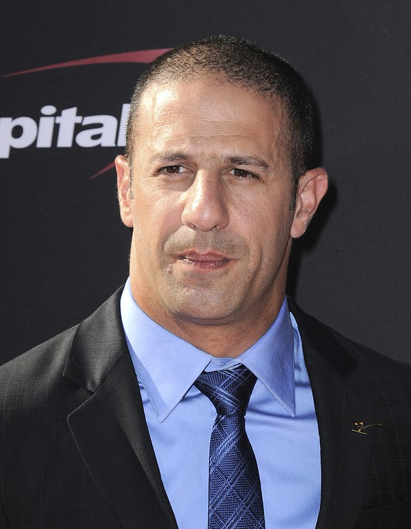 . IndyCar driver Tony Kanaan, of Brazil, arrives at the ESPY Awards on Wednesday, July 17, 2013, at Nokia Theater in Los Angeles. (Photo by Jordan Strauss/Invision/AP)