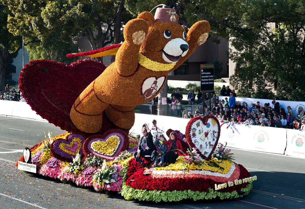 ". Shriners Hospitals for Children ""Love to the Rescue\"" float during 2014 Rose Parade in Pasadena, Calif. on January 1, 2014. This float won Tournament Volunteers award for best floral design of parade theme for floats under 35 feet. (Staff photo by Leo Jarzomb/ Pasadena Star-News)"