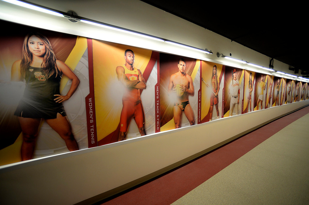 . Portraits of contemporary athletes who are at the top of their game. Heritage Hall, which houses USC\'s athletic department, has been closed for the past year while undergoing a $35-million renovation.  The building first opened in 1971 at a cost of $2.8 million and was originally 48,000 square feet. It now is 80,000 square feet. As part of the renovation, Heritage Hall\'s two-story lobby has been transformed into a state-of-the-art museum space featuring interactive displays. Heritage Hall also includes a sports performance center, a broadcast studio, a lounge for Women of Troy student-athletes, a rowing ergometer room and an indoor golf driving area, plus new locker rooms, meeting rooms, equipment room and event space.   Los Angeles , CA. January 30, 2014 (Photo by John McCoy / Los Angeles Daily News)
