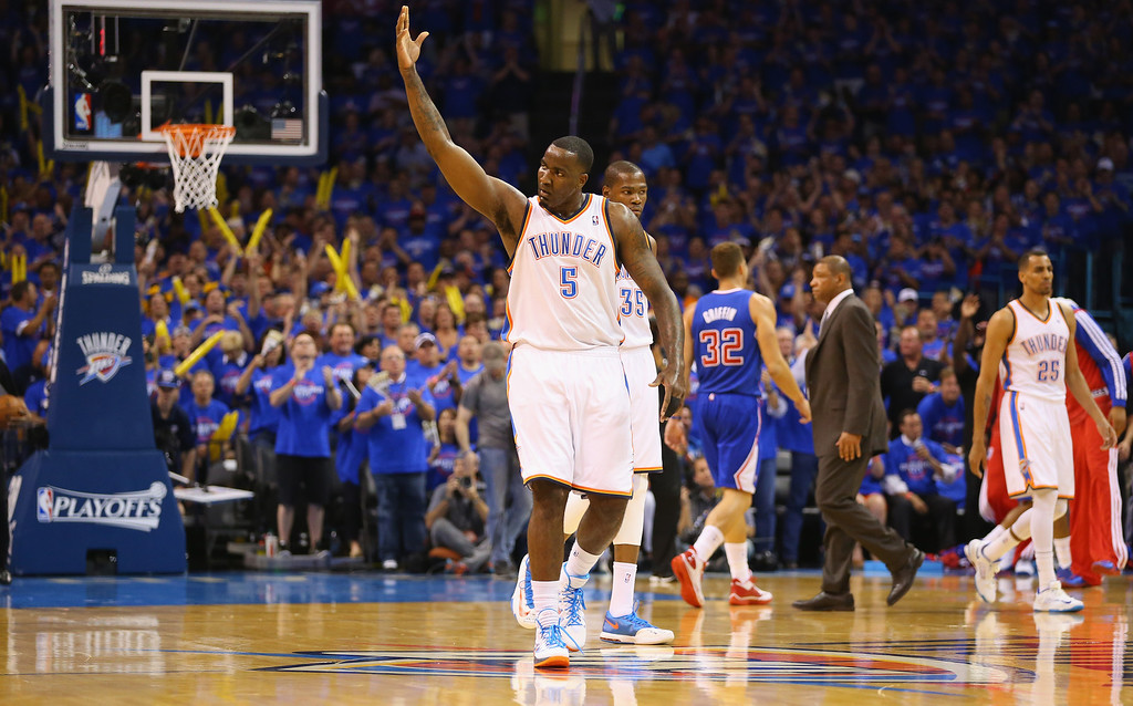 . Kendrick Perkins #5 of the Oklahoma City Thunder reacts against the Los Angeles Clippersin Game One of the Western Conference Semifinals during the 2014 NBA Playoffs at Chesapeake Energy Arena on May 5, 2014 in Oklahoma City, Oklahoma.   (Photo by Ronald Martinez/Getty Images)