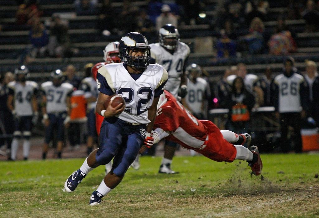 . Running back Dathan Baliey #22 of El Segundo runs with the ball against the defense of Lawndale in a Pioneer League matchup at Leuzinger High School on Friday, October 11, 2013 in Lawndale, Calif.  (Michael Yanow / For the Daily Breeze)