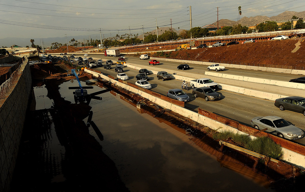 . Traffic is congested at the 14th Street exit from the 91 East Freeway due to flooding  in Riverside August 29, 2013.    GABRIEL LUIS ACOSTA/STAFF PHOTOGRAPHER.