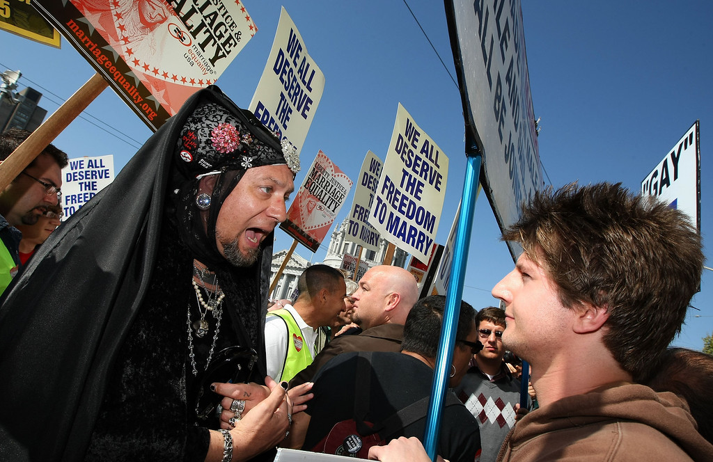 . SAN FRANCISCO - MAY 26:  Propsition 8 opponent Sister Maudlin Mascara (L) argues with Proposition 8 supporter George Papko outside of the California Supreme Court May 26, 2009 in San Francisco, California. The California State Supreme Court voted 6-1 to uphold proposition 8 which makes it illegal for same-sex couples to marry in the state of California. More than 18,000 same-sex couples that wed before prop 8 was voted in will still be legally married.  (Photo by Justin Sullivan/Getty Images)