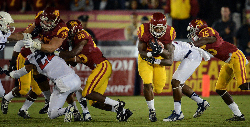 . USC\'s  Tre Madden #23 breaks through the line during their game against Arizona at the Los Angeles Memorial Coliseum Thursday, October 10, 2013. (Photo by Hans Gutknecht/Los Angeles Daily News)