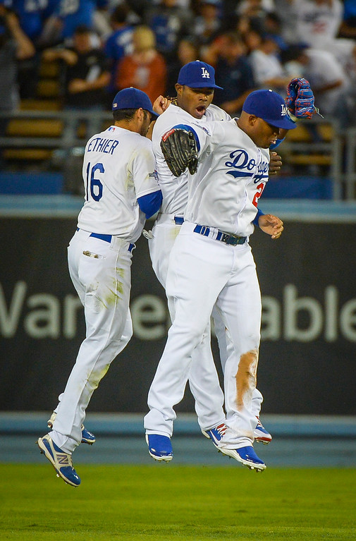 . Dodgers\' Andre Ethier, Yasiel Puig and Carl Crawford celebrate their 3-0 win over  the Cardinals in game 3 of the NLCS series at Dodger stadium Monday, October 14, 2013 ( Photo by Andy Holzman/Los Angeles Daily News )