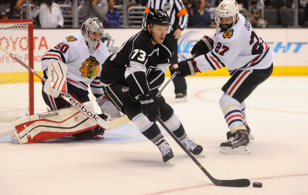 . The Kings\' Tyler Toffoli gets the puck in front of Blackhawks goalie Corey Crawford and Johnny Oduya during game six of the Western Conference Finals, Friday, May 30, 2014, at Staples Center. (Photo by Michael Owen Baker/Los Angeles Daily News)
