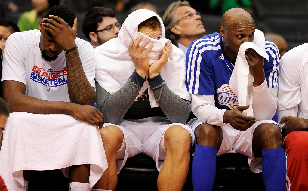 . Clippers\' DeAndre Jordan #6, Blake Griffin #32 and Lamar Odom #7 hang their heads on the bench during their game at the Staples Center in Los Angeles Friday, February  21, 2013.  (Hans Gutknecht/Los Angeles Daily News)