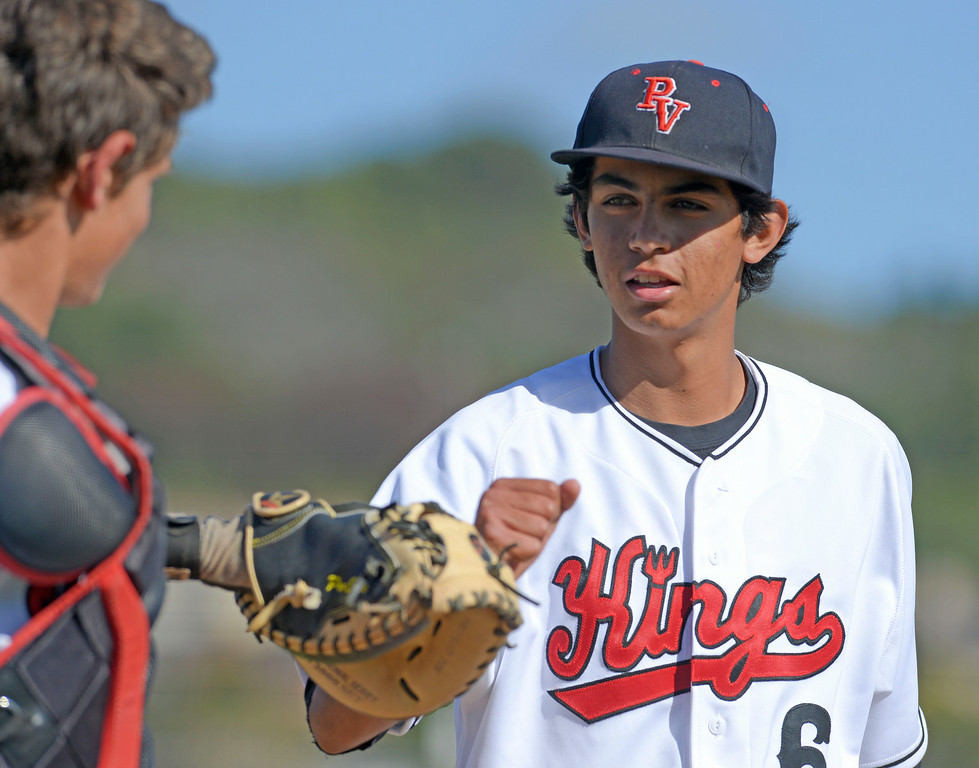 . Palos Verdes catcher Joe Caparis (40) and pitcher Erik Gutierrez (6)fist-bump after knocking down South batters in an Anaheim Lions Tournament baseball game Tuesday, April 01, 2014, in Palos Verdes Estates, CA. Palos Verdes won 8-0.