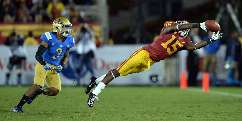 . USC�s Nelson Agholor #15 can\'s make the catch as UCLA�s Randall Goforth #3 defends during their game at the Los Angeles Memorial Coliseum Saturday, November 30, 2013.  UCLA beat USC 35-14. (Photo by Hans Gutknecht/Los Angeles Daily News)