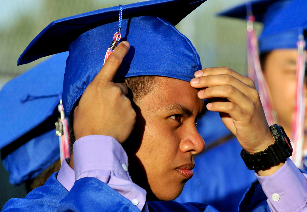 . Graduate Bernardo Lector, 18, gets ready to enter the stadium.  Los Altos High School\'s 53 Commencement Ceremonies held in the Patrick Mauch Memorial Stadium, Tuesday, May 21, 2013.  (Correspondent photo/Mike Mullen)