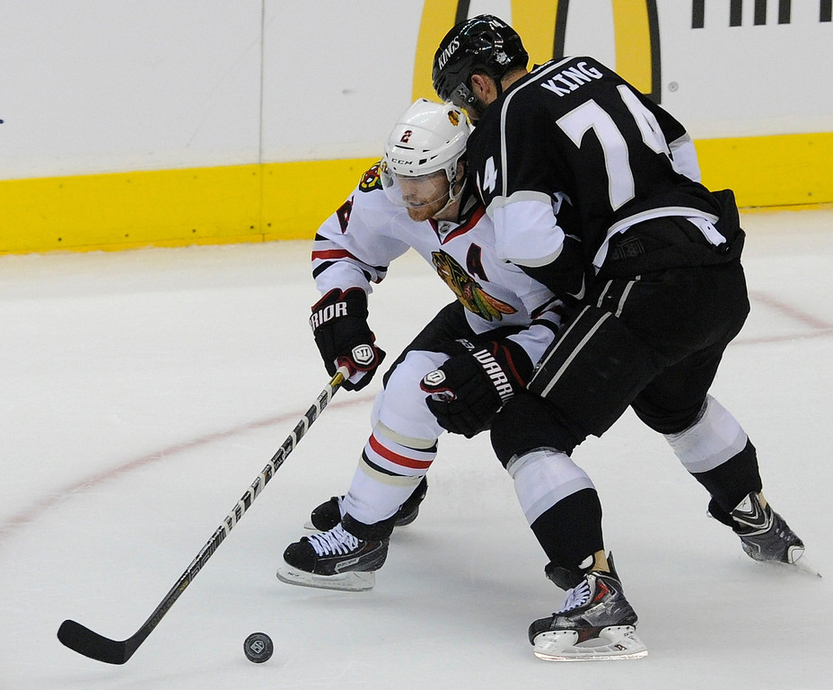 . Blackhawks#2 Duncan Keith gets hassled by Kings#74 Dwight King who dropped his stick, but still went for the puck in the 2nd period. The Kings played the Chicago Blackhawks in the 3rd game of the Western Conference Finals. Los Angeles, CA 6/4/2013(John McCoy/LA Daily News4