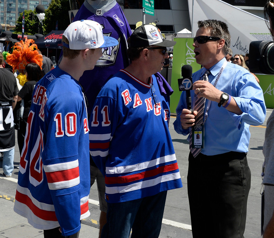 . June 13,2014. Los Angeles. CA.  A couple of brave NY Ranger fans take with the locate TV news, as thousands of LA King fans arrive hours early at Staples Center for game 5 of the Stanley Cup Playoffs. Photo by Gene Blevins/LA DailyNews