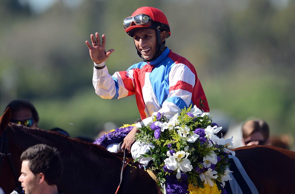 ". Jockey Julien Leparoux atop \""Sweet Lulu\"" waves after winning the sixth race during the Breeders\' Cup at Santa Anita Park in Arcadia, Calif., on Saturday, Nov. 2, 2013.    (Keith Birmingham Pasadena Star-News)"