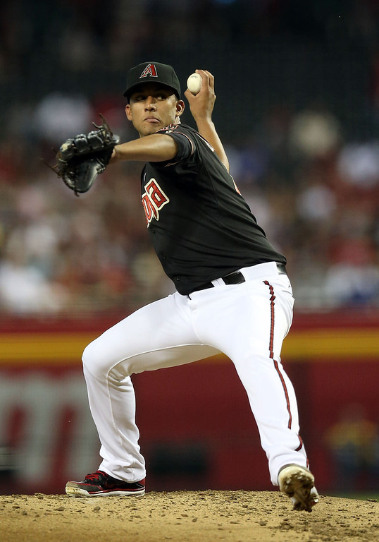 . PHOENIX, AZ - JULY 08:  Starting pitcher Randall Delgado #48 of the Arizona Diamondbacks pitches against the Los Angeles Dodgers during the MLB game at Chase Field on July 8, 2013 in Phoenix, Arizona.  (Photo by Christian Petersen/Getty Images)