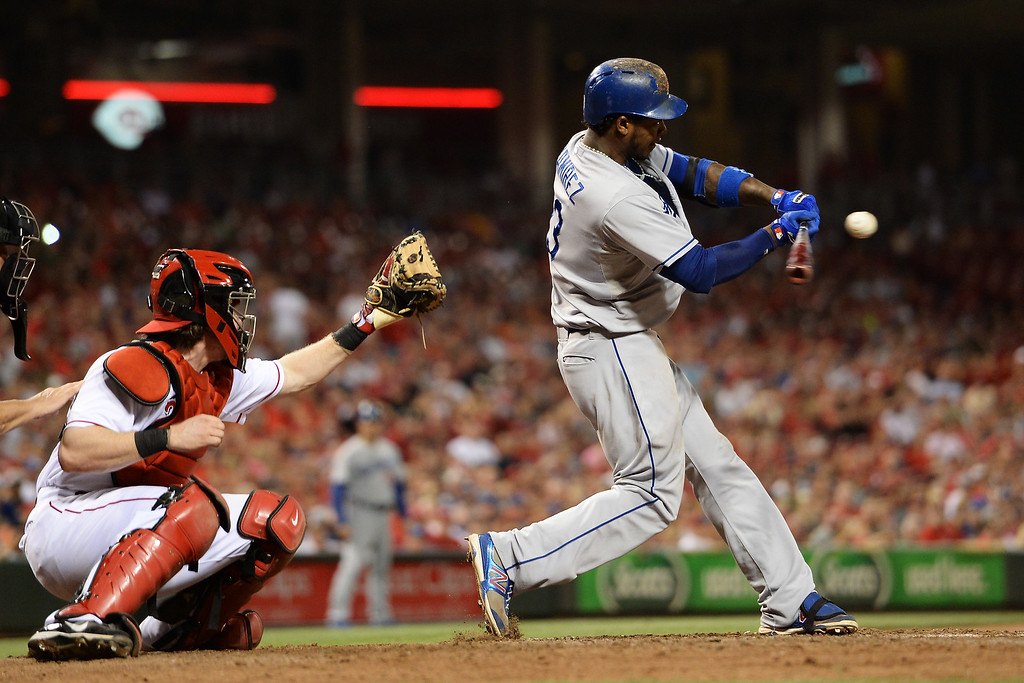 . CINCINNATI, OH - SEPTEMBER 8:  Hanley Ramirez #13 of the Los Angeles Dodgers strikes out in the ninth inning against the Cincinnati Reds at Great American Ball Park on September 8, 2013 in Cincinnati, Ohio.Ramirez had a home run earlier in the game but Cincinnati defeated Los Angeles 3-2 to sweep the series.  (Photo by Jamie Sabau/Getty Images)