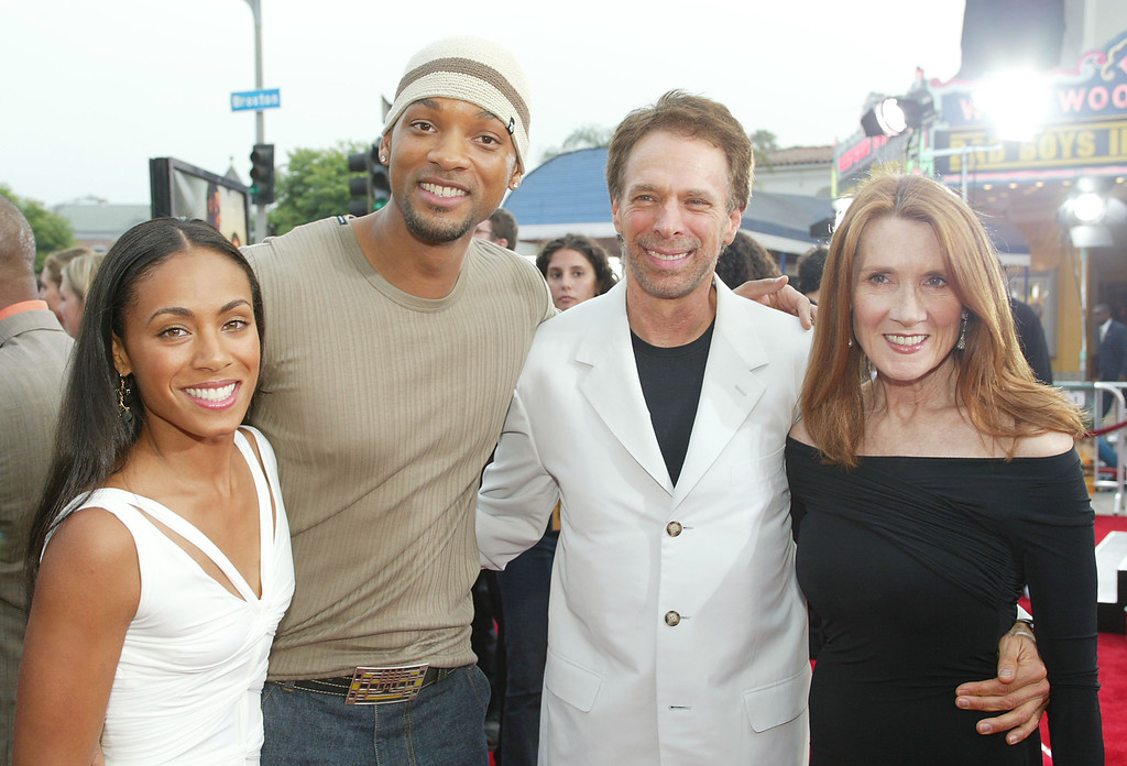 """. WESTWOOD, CA - JULY 9:  (L-R)  Actors Jada Pinkett, husband Will Smith, producer Jerry Bruckheimer with wife Bonnie attend the \""""Bad Boys II\"""" movie premiere at the Mann\'s Village theatre on July 9, 2003 in Westwood,  California.  (Photo by Kevin Winter/Getty Images)"""