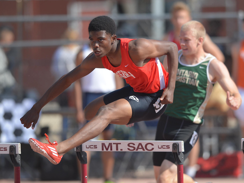 . Serra\'s Lloyd Siscard en route to a win in the 300 meter Division 4 intermediate hurdles race of the CIF Southern Section Track and Field Championships Saturday at Mt. SAC. 20130518 Photo by Steve McCrank / Staff Photographer