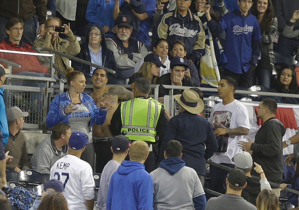 . San Diego police with the help of Petco Park security make an arrest while breaking up a fight in the stands during baseball game between the San Diego Padres and the Los Angeles Dodgers in San Diego, Thursday, April 11, 2013. The Padres and Dodgers engaged in a brawl in the sixth inning before fights broke out in the stands. wbb(AP Photo/Lenny Ignelzi)