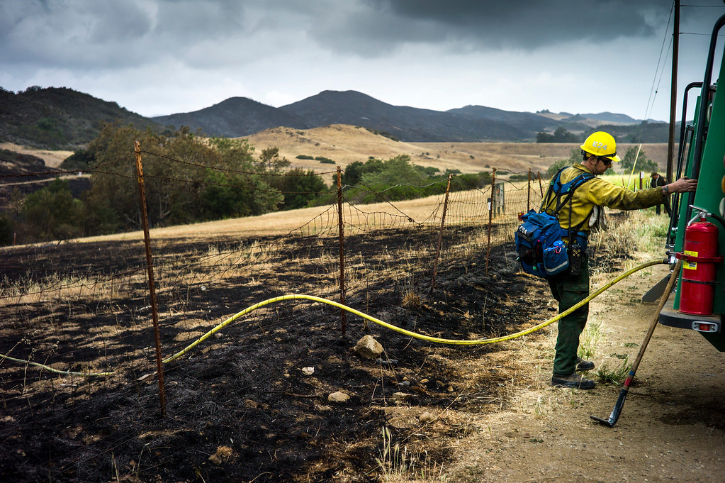 . Wes Krahlwest of the US Forrest Service works on the last remaining hot spots of the Spring fire off of Protrero road near Hidden Valley Sunday.  Cool damp weather has helped crews begin to get the upper hand on the fire which has burned more than 10,000 acres.  Photo by David Crane/Los Angeles Daily News.