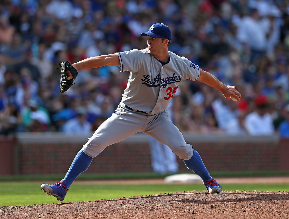 . Starting pitcher Chris Capuano #35 of the Los Angeles Dodgers delivers the ball against the Chicago Cubs at Wrigley Field on August 3, 2013 in Chicago, Illinois. The Dodgers defeated the Cubs 3-0.  (Photo by Jonathan Daniel/Getty Images)