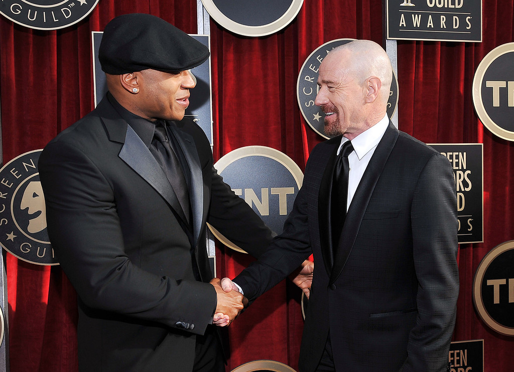 . LL Cool J, left, and Bryan Cranston arrive at the 17th Annual Screen Actors Guild Awards on Sunday, Jan. 30, 2011 in Los Angeles. (AP Photo/Vince Bucci)