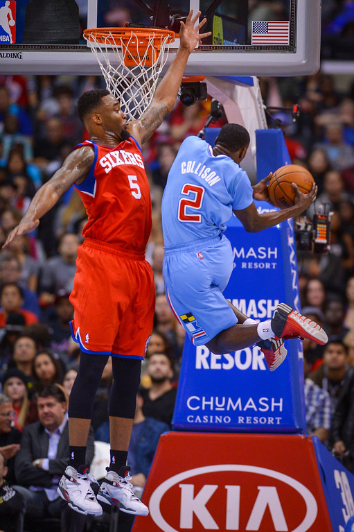 . Clippers� Darren Collison drives up for tow points as 76ers� Arnett Moultrie defends on the play at Staples Center Sunday.  The Clippers defeated the 76ers 124-78.  ( Photo by David Crane/Los Angeles Daily News )