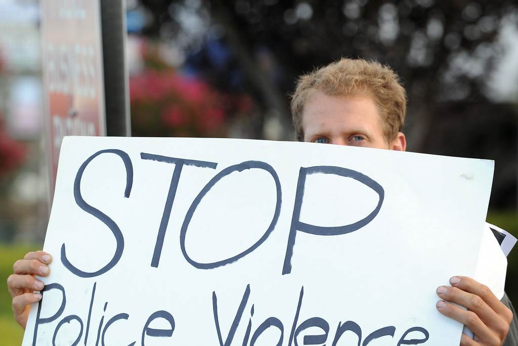 . Max Estela, 24, of Ontario, participates in a protest against police brutality in honor of Dante Parker on Wednesday, August 20, 2014 in Victorville, Ca.  The protest was organized by CopsWatch IE and drew about thirty people. (Photo by Micah Escamilla/The Sun)