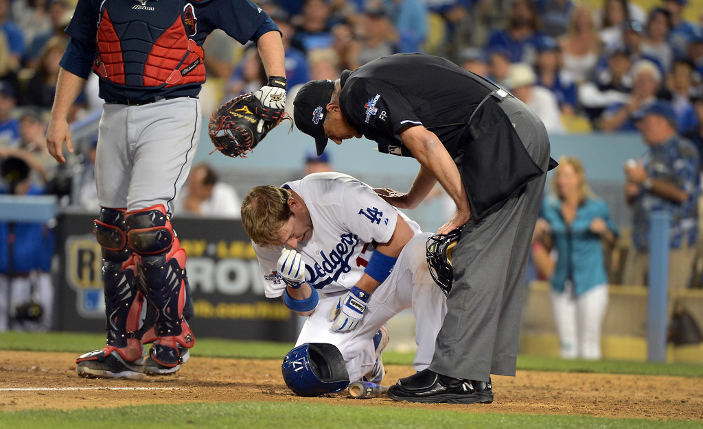 . Dodgers\' A.J. Ellis is in pain after being hit in the elboe during game 3 of the NLDS at Dodger Stadium Sunday, October 6, 2013. (Photo by David Crane/Los Angeles Daily News)