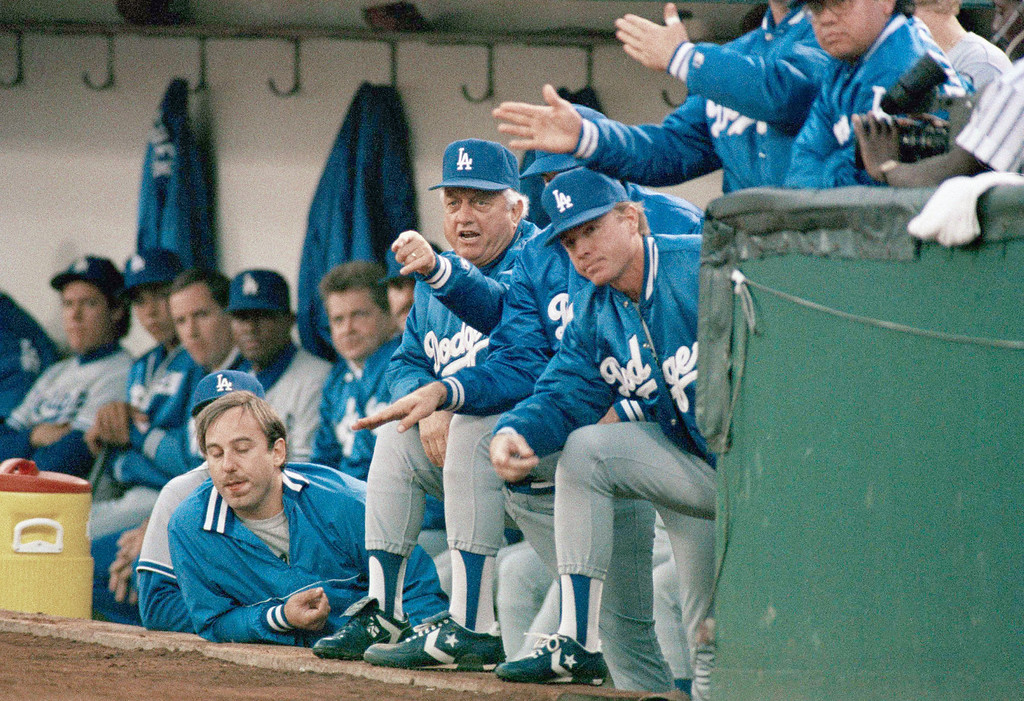 . Los Angeles Dodgers manager Tommy Lasorda, left, gestures form the dugout during the Dodgers 4-3 win over the Oakland A\'s in the fourth game of the World Series, Oct. 19, 1988 in Oakland. Lasorda\'s managing has helped to lift the Dodgers to a commanding 3-1 lead despite being crippled by key injuries. (AP Photo/Lennox McLendon)