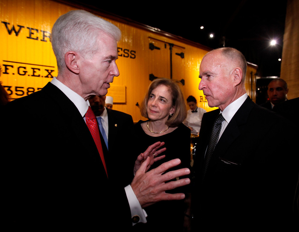. Former Gov. Gray Davis, left, talks with newly sworn-in Gov. Jerry Brown, as Brown\'s wife, Anne Gust Brown, center, looks on during a reception held for Brown at the California Railroad Museum in Sacramento, Calif., Monday, Jan. 3, 2011. Davis served as Brown\'s chief of staff during Brown\'s first tenure as California\'s Governor in the 1970\'s.(AP Photo/Rich Pedroncelli)